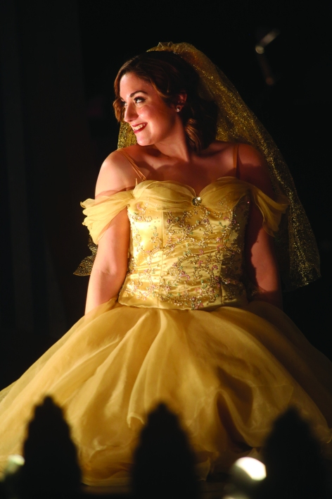 Cinderella, played by Courtney Elvira, is the mystery woman arriving at the palace for the ball. The Des Moines Metro Opera's OPERA Iowa educational program presented Rossini's Cinderella Feb. 28 at Indianola High School.